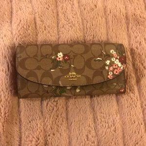 Floral Coach wallet.